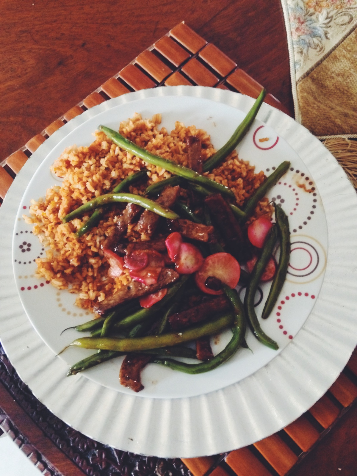 Green beans and radishes on a bed of spicy brown rice and Fry's thick cut chunky strips